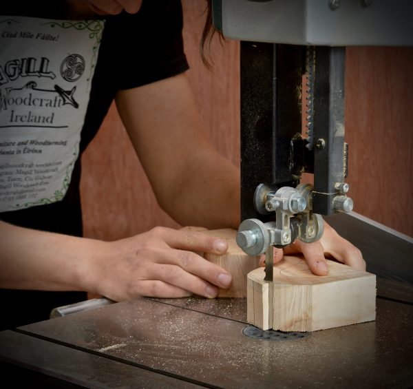 Cian Magill Woodcraft bandsaw with hands and wood